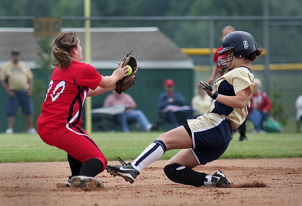 Record-Eagle/ Keith King<br /> Traverse City St. Francis' Sydni Zamarron, right, is confronted by Onaway's Emily Estep as she slides into second base.