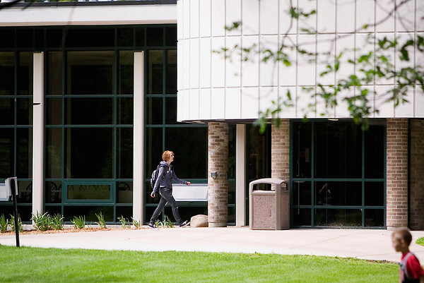 Record-Eagle/Jan-Michael Stump<br /> Laurie Lawrence, of Traverse City, walks by East Hall on the campus of Northwestern Michigan College, where enrollment is up for the sixth consecutive semester.