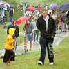 Record-Eagle/ Keith King<br /> Spectators disperse as rain falls during the Division 4 state quarterfinal softball and baseball games Tuesday at Traverse City West High School. The rain delayed the sporting events for approximately an hour.