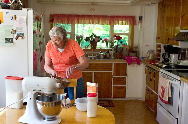 Record-Eagle/Jan-Michael Stump<br /> In her Central Lake kitchen, Carolyn Wolgamott makes the Hot Water Sponge Cake she says she her husband, Verl, and their eight children loved.