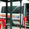 Record-Eagle/Sarah Brower<br /> Tom Menzel, executive director of BATA, steps out of a BATA bus after a ribbon-cutting ceremony at Grand Traverse Pavilions celebrating the opening of 14 new bus shelters.