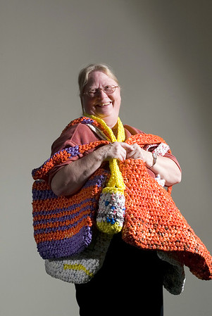Record-Eagle/Jan-Michael Stump<br /> Sandy Schefke cuts plastic bags into circular strips, then ties them together and crochets them into her Friendeco bags.
