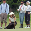 "Record-Eagle/Sarah Brower<br /> On Friday, Elmwood golf course had its 7th annual ""The Haig"" hickory stick golf tournament that honors professional golfer Walter Hagen. Andrew Walukonis, Lindsey Jonkhoff, Travis Beynon, and Peg Jonkhoff line up a putt on the 17th green."