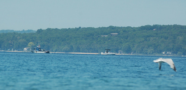 Record-Eagle/Sarah Brower<br /> A Grand Traverse County Police boat and two Michigan State Police boats continue to search for a man near Deepwater Point in East Bay.