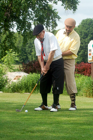 "Record-Eagle/Sarah Brower<br /> On Friday, Elmwood golf course had its 7th annual ""The Haig"" hickory stick golf tournament that honors professional golfer Walter Hagen. Dr. Joe Gadbaw starts the event by teeing off first with the help of his son, John Gadbaw."