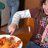 Record-Eagle/Sarah Brower<br /> Rachel Bryan, 8, enjoys dad Mike Bryan's Jumbo Stuffed Shells.