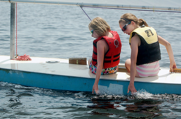 Record-Eagle/Sarah Brower<br /> Nonprofit organization Traverse Area Community Sailing recently held their camp, teaching students how to sail on Boardman Lake. Sailing partners Grace Allen, left, and Erin Kiessling test the water.