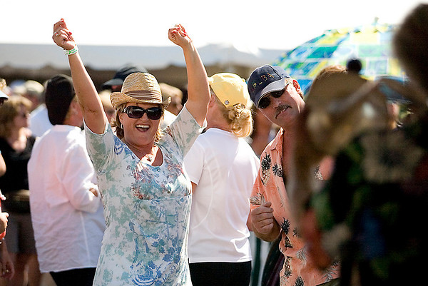 Record-Eagle/Jan-Michael Stump<br /> Cheri Arcineiga, left, and Guy McDonald dance to the Fabulous Horndogs during Saturday's festival.