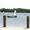 Record-Eagle/Sarah Brower<br /> Nonprofit organization Traverse Area Community Sailing recently held their camp, teaching students how to sail on Boardman Lake. A camp leader watches the boats from the dock. Ben Ferris, summer camp director, said they have about 300 children, along with 25 to 30 adults, attend camp each summer.