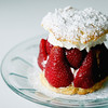 """Record-Eagle/Jan-Michael Stump<br /> A """"mortar"""" of whipped cream holds an outer wall of strawberries, which is then filled in with more strawberries on Silver Swan's Strawberry shortcake. A topping of whipped cream then holds on the top layer of shortcake."""
