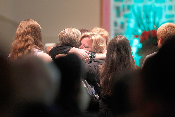 Record-Eagle/Jan-Michael Stump<br /> Susie Lewis greets mourners at West Side Community Church before the start of Monday's funeral for her daughter Carly Lewis, who was found slain last week after being missing for 12 days.