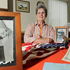 Record-Eagle/Keith King<br /> Eve Howe, of Suttons Bay, displays items relating to her father, Anthonius Bartholomeus Hendrikus, and his immigration from Holland to the United States. Some of the items include the first American flag her father bought in the U.S., which has 48 stars, and her father's Certificate of Naturalization.