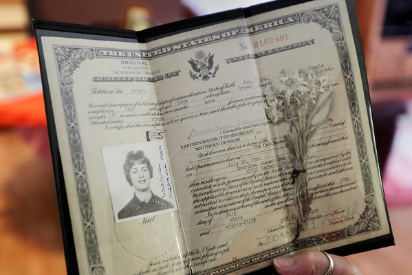 Record-Eagle/Keith King<br /> Eve Howe, of Suttons Bay, holds her Certificate of Naturalization.
