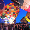 Record-Eagle/Jan-Michael Stump<br /> Hot air balloons light up at the Open Space Friday during the Grand Traverse Balloon Classic, which continues through this morning; there will be one more sunrise launch at 6 a.m. About 25 hot air balloons are in Traverse City for the event, which is being held for the first time.
