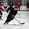 Record-Eagle/ Keith King<br /> Cooper Macdonell skates during a Team North hockey team practice Tuesday.