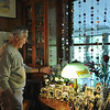 Record-Eagle/ Vanessa McCray<br /> David Chrobak points out a bouquet of delicately beaded flowers inside the dining room of his Old Mill Pond Inn. The collector is preparing to open a resale shop and consignment store to gradually sell off his belongings.