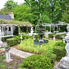 Record-Eagle/ Vanessa McCray<br /> The garden of Old Mill Pond Inn in Northport is full of plant life and sculptures collected by owner David Chrobak.