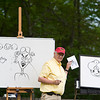 Record-Eagle/Jan-Michael Stump<br /> Traverse City cartoonist Dick Evans gives a drawing lesson to attendees at Monday's Summer Solstice Celebration at the Lighthouse, hosted by the Peninsula Township Library and Peninsula Parks.