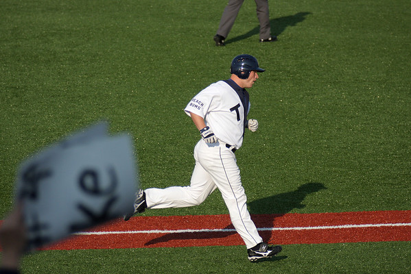 Record-Eagle/ Keith King<br /> Traverse City's Chase Burch comes home after hitting a home run Thursday.