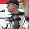 Record-Eagle/ Keith King<br /> Allen Wolfe, of Suttons Bay, along with other members of the band Handy Billy, performs in Haserot Park during the Northport Lighthouse and Maritime Festival.