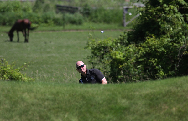 Record-Eagle/ Keith King<br /> Gene Davis, the current superintendent of the Wolverine and Spruce Run golf courses, hits the ball toward the green on the fifth hole. The Grand Traverse Resort & Spa celebrated the 25th anniversary  of The Bear on Tuesday with a golf tournament.