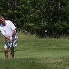 Record-Eagle/ Keith King<br /> Bob Lober, Executive Director of the Traverse City Junior Golf Association, chips toward the pin. The Grand Traverse Resort & Spa celebrated the 25th anniversary  of The Bear on Tuesday with a golf tournament.
