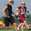 Record-Eagle/ Keith King<br /> Mike Hansen (34) runs through drills with his TC Wolves teammates at practice Thursday.