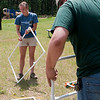 Record-Eagle/Douglas Tesner<br /> Norah Chalker and Tom Pecar set up ladder golf at Interlochen State Park. It was one of the games scheduled to be played during celebrations for the 90th anniversary of the state parks system. Interlochen State Park was created in 1917, two years before the system was formed.