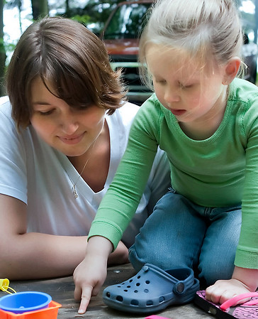 Record-Eagle/Douglas Tesner<br /> Laura Thorson and her daughter Ivy check out an inchworm on their picnic table at Interlochen State Park. Laura has been visiting the park since she was a young girl and hopes he daughter can do the same.