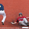 Record-Eagle/Douglas Tesner<br /> Washington's Alan Robbins (6) slides into third base after a sixth-inning triple as Kyle Maunus awaits a throw.