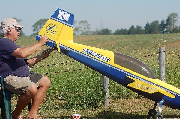 Record-Eagle/Sarah Brower<br /> Mark Hamlyn prepares to fly his Extra 300 Extreme Flight airplane during practice for the air show in Empire this weekend.