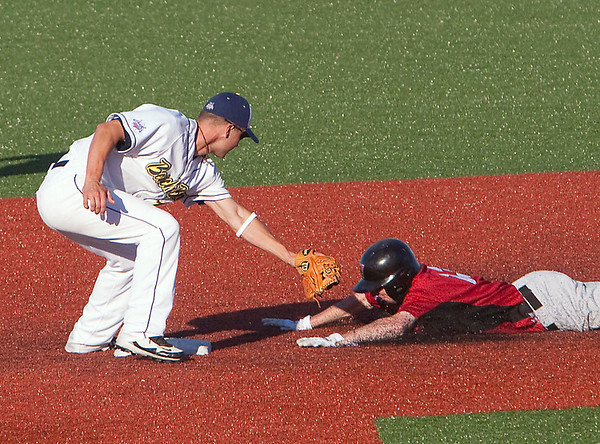 Record-Eagle/Douglas Tesner<br /> Beach Bums shortstop Brad Miller tags out Brett Grandstrand on an attempted steal.