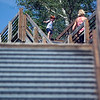 Record-Eagle/Jan-Michael Stump<br /> Lori Halberg and her son Trevor, 3, climb down the steps from the Arcadia Scenic Turnout along <br /> M-22.