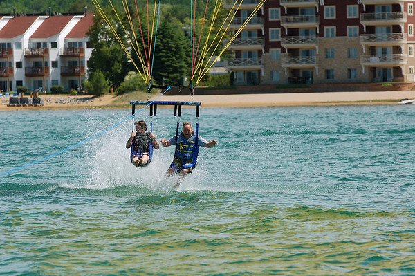 Record-Eagle/Sarah Brower<br /> Lisa and Kevin Bowman, of Dayton, Ohio, take their first parasail ride Thursday from Traverse Bay Parasail located at Sugar Beach Resort Hotel on East Bay.
