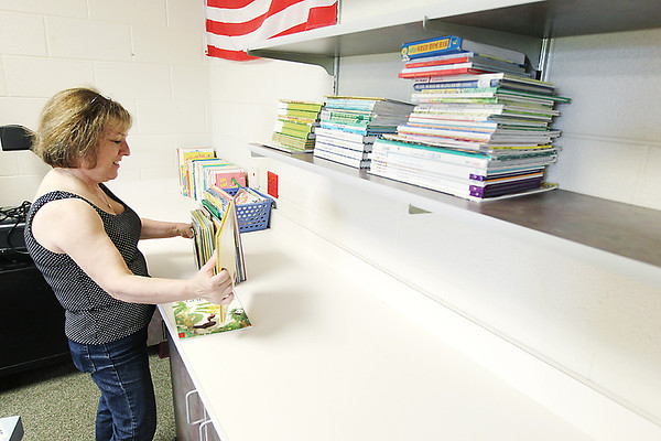 Record-Eagle/Keith King<br /> Linda Yahr, kindergarten and first-grade teacher at Traverse City Christian Elementary School, organizes materials in her new classroom on the Emerson Road campus.
