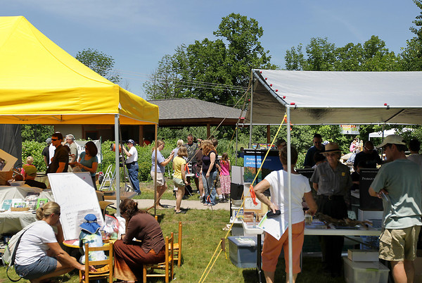 Record-Eagle/Keith King<br /> People attending the 3rd annual Boardman River Nature Fest on Saturday browse among the booths and exhibits at the Boardman River Nature Center on Cass Road.