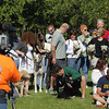 "Record-Eagle/Keith King<br /> Dogs and their owners get into position as they prepare to be video-recorded by Trent Tomlinson, left, of Traverse City, on Saturday near the intersection of Division and 11th Street for an entry in the PetSafe ""Bark for Your Park"" dog park contest. The winner of the national contest will be awarded $100,000 toward a dog park. PetSafe, based in Knoxville, Tenn., plans to post videos of the finalists July 13, when people can start voting for the winner. Voting will be open for three weeks. More information is available at  <a href=""http://www.barkforyourpark.com"">http://www.barkforyourpark.com</a>."