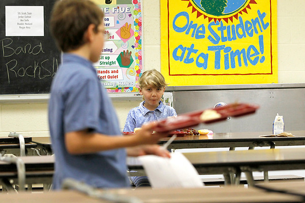 Record-Eagle/Jan-Michael Stump<br /> Ann Marie Lortet, right, watches her brother, John Michael, during lunch at Fife Lake Elementary School on Friday.