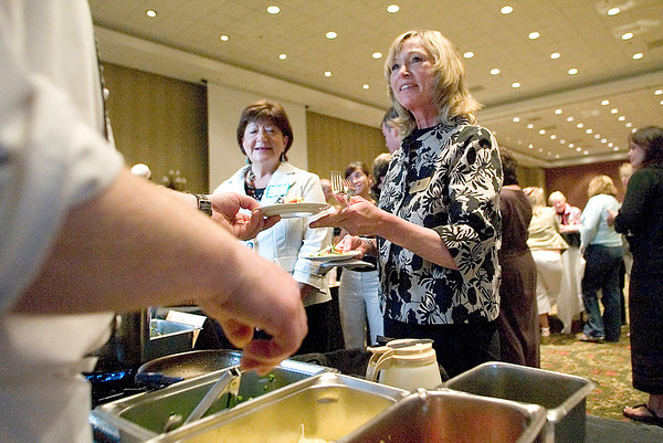 Record-Eagle/Jan-Michael Stump<br /> Eileen Brys takes a sample of bowtie pasta with asparagus sauce made by chef Darren Hawley, of Crystal Mountain, during Tuesday's Taste the Local Difference event at the Grand Traverse Resort and Spa. The event featured locally made food and produce from the Grand Traverse Area.