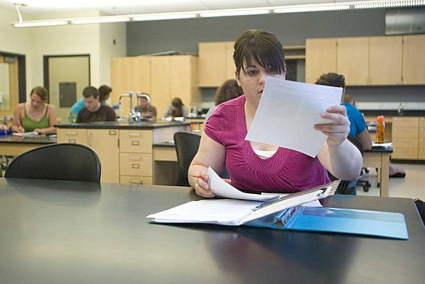 Record-Eagle/Jan-Michael Stump<br /> Meagan Krueger looks over notes in her human biology class at Northwestern Michigan College, where the Grand Valley State University art and design major is taking classes this summer.