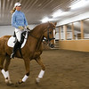 Record-Eagle/Douglas Tesner<br /> Betsy Van Dyke, a professional instructor, works with her horse, Cantana,  at Walton Farms.  Van Dike and Cantana will be competing in the Horse Show by the Bay this year.