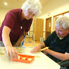Record-Eagle/Sarah Brower<br /> The Lighthouse Neurological Rehabilitation Center recently opened an 11,000-square-foot therapy center. Linda McClain, a rehabilitation aide, plays a memory game with Duane Strom, of Cadillac.