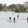 Record-Eagle/Keith King<br /> Boardman River Stand Up Paddleboard Race participants travel on Boardman Lake toward the Boardman River during the Great Wakes Festival.