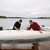 Record-Eagle/Keith King<br /> Ben Corwin, left, instructor at Traverse Area Community Sailing, and Russ Spranger, fleet maintenance director, clean a sailboat at the Gordon and Jean Cornwell Sailing Center on Boardman Lake in Traverse City.