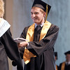Record-Eagle/Keith King<br /> Alec Chereskin walks across the stage Sundayat Kresge Auditorium during the Traverse City Central High School commencement at the Interlochen Center for the Arts.