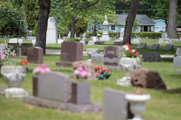 Record-Eagle/Jan-Michael Stump<br /> Traverse City is reducing its maintenance services at Oakwood Cemetery as part of overall budget cuts.