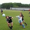 Record-Eagle/Mike Eckert<br /> Glen Lake's Sarah Tondreau heads the ball as dani Heger of TC Liberty closes in