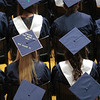 Record-Eagle/Jan-Michael Stump<br /> Some Traverse City St. Francis seniors decorated their mortar boards for Sunday's graduation.