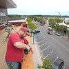 Record-Eagle/Jan-Michael Stump<br /> Bud Schrader works on the balcony of a new building in downtown Frankfort, which will hold two second-story condos and one 3,300 square-foot condo when it is completed.