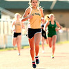 Record-Eagle/Jan-Michael Stump<br /> Traverse City St. Francis' Lauren Buckel wins the 400 meter dash in Tuesday's Honor Roll Meet at Traverse City Central.